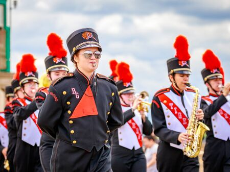 marching band: Portland, Oregon, USA - June 11, 2016: Battle Ground High School Marching Band in the Grand Floral Parade during Portland Rose Festival 2016.