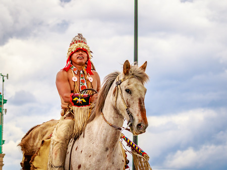 chiefs: Portland, Oregon, USA - June 11, 2016: Happy Canyon Chiefs of the Confederated Tribes of the Umatilla Indian Reservation in the Grand Floral Parade during Portland Rose Festival 2016.