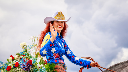 cheyenne: Portland, Oregon, USA - June 11, 2016: Miss Vancouver Rodeo, Cheyenne Ward in the Grand Floral Parade during Portland Rose Festival 2016.