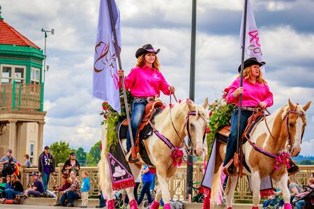 40 something: Portland, Oregon, USA - June 11, 2016: 40 Something Cowgirls in the Grand Floral Parade during Portland Rose Festival 2016.