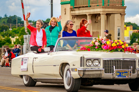 bennett: Portland, Oregon, USA - June 11, 2016: 50-year Court with 1966 Rose Festival President Floyd Bennett, and Muriel Giorgi, Granddaughter of 100-year Queen Muriel Saling in the Grand Floral Parade during Portland Rose Festival 2016. Editorial