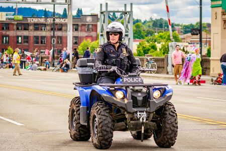 bureau: Portland, Oregon, USA - June 11, 2016: Portland Police Bureau in the Grand Floral Parade during Portland Rose Festival 2016. Editorial
