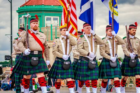 scots: Portland, Oregon, USA - June 11, 2016: Northwest Scots Honor Guard in the Grand Floral Parade during Portland Rose Festival 2016.