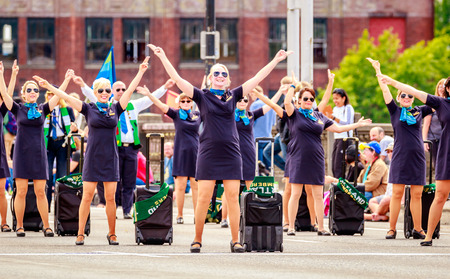 Portland, Oregon, USA - June 11, 2016: Alaska Airlines Drill Team in the Grand Floral Parade during Portland Rose Festival 2016.