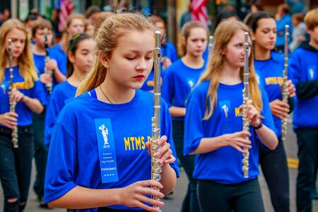 Portland, Oregon, USA - November 11, 2016: Mt. Tabor Middle School Marching Band in the annual Ross Hollywood Chapel Veterans Day Parade, in northeast Portland.