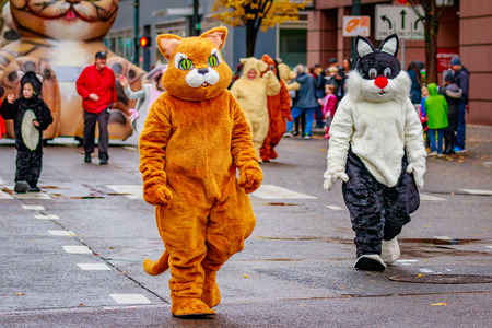 costumed: Portland, Oregon, USA - November 25, 2016: Costumed characters march in the annual My Macys holiday Parade across Portland Downtown. Editorial