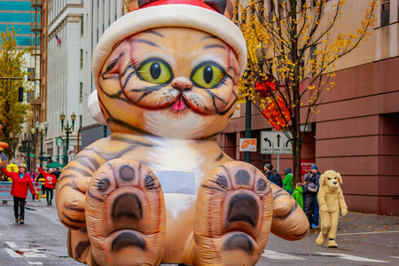 Portland, Oregon, USA - November 25, 2016: Giant cat float marches in the annual My Macys holiday Parade across Portland Downtown. Editorial