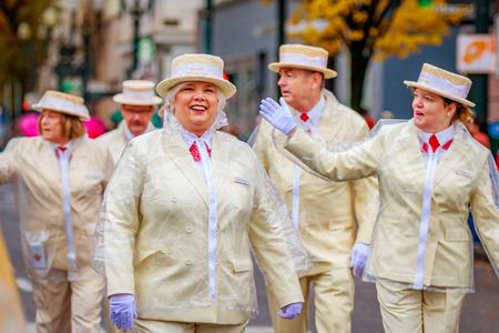 Portland, Oregon, USA - November 25, 2016: Portland Rose Society march in the annual My Macys holiday Parade across Portland Downtown.