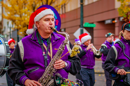 Portland, Oregon, USA - November 25, 2016: The Beat Goes On Marching Band in the annual My Macys holiday Parade across Portland Downtown.