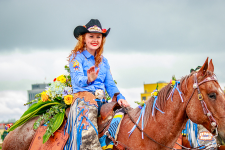 Portland, Oregon, USA - June 10, 2017: St. Paul Rodeo Court in the Grand Floral Parade, as it stretched through the rain, during Portland Rose Festival 2017.