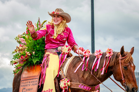 county fair: Portland, Oregon, USA - June 10, 2017: Clackamas County Fair & Canby Rodeo Court in the Grand Floral Parade, as it stretched through the rain, during Portland Rose Festival 2017. Editorial