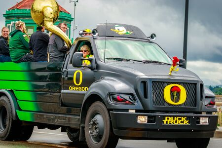 Portland, Oregon, USA - June 10, 2017: University of Oregon Duck truck and Pep band in the Grand Floral Parade, as it stretched through the rain, during Portland Rose Festival 2017. Editorial