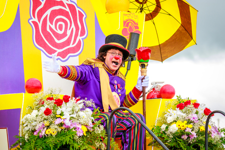 Portland, Oregon, USA - June 10, 2017: Clown Prince , Angel Ocasio, in the Grand Floral Parade, as it stretched through the rain, during Portland Rose Festival 2017.