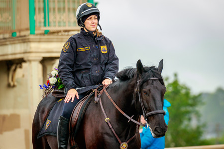Portland, Oregon, USA - June 10, 2017: Portland Police Mounted Patrol in the Grand Floral Parade, as it stretched through the rain, during Portland Rose Festival 2017. Editorial