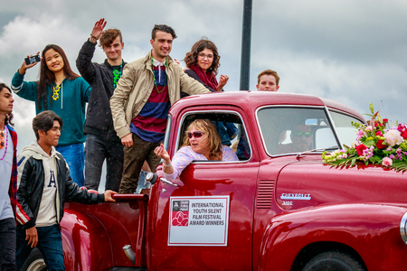Portland, Oregon, USA - June 10, 2017: International Youth Silent Film Festival Winners in the Grand Floral Parade, as it stretched through the rain, during Portland Rose Festival 2017.