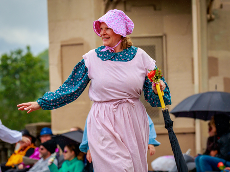 Portland, Oregon, USA - June 10, 2017: Sons & Daughters of Oregon Pioneers in the Grand Floral Parade, as it stretched through the rain, during Portland Rose Festival 2017. Editorial