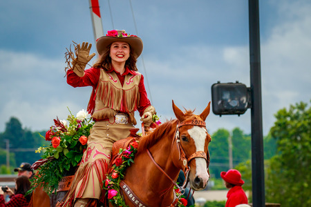 Portland, Oregon, USA - June 10, 2017: Pendleton Round-Up Court in the Grand Floral Parade, as it stretched through the rain, during Portland Rose Festival 2017.