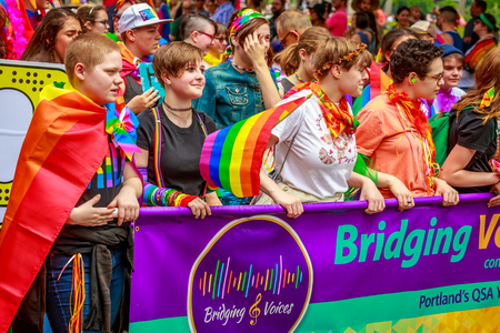 Portland, Oregon, USA - June 18, 2017: Bridging Voices: Oregon's Only Queer Straight Allied Youth Chorus in Portlands 2017 Pride Parade.