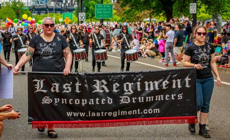 regiment: Portland, Oregon, USA - June 18, 2017: The Last Regiment Of Syncopated Drummers in Portlands 2017 Pride Parade, which reflects the community diversity.
