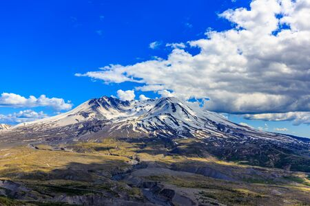 Snow on Mount St. Helens against Blue Sky and cloudscape