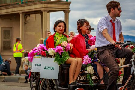 Portland, Oregon, USA - June 8, 2019: City of Portland Sister Cities Coalition in the Grand Floral Parade, during Portland Rose Festival 2019.
