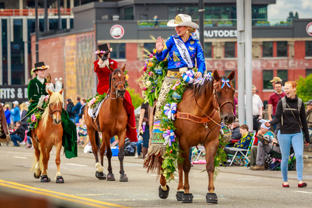 Portland, Oregon, USA - June 8, 2019: Miss Rodeo Oregon, Taylor Ann Skramstad, in the Grand Floral Parade, during Portland Rose Festival 2019. 報道画像