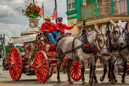 Portland, Oregon, USA - June 8, 2019: Portland Fire & Rescue Vintage Steamer in the Grand Floral Parade, during Portland Rose Festival 2019.