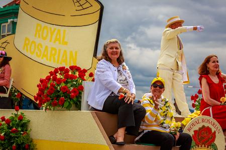 Portland, Oregon, USA - June 8, 2019: Royal Rosarian Foundation Float in the Grand Floral Parade, during Portland Rose Festival 2019.