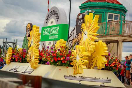 Portland, Oregon, USA - June 8, 2019: Gunderson 100-year float in the Grand Floral Parade, during Portland Rose Festival 2019.