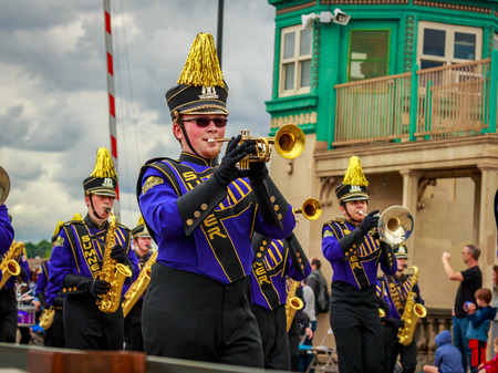 Portland, Oregon, USA - June 8, 2019: Sumner High School Spartan Marching Band in the Grand Floral Parade, during Portland Rose Festival 2019. 報道画像