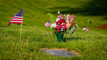 US Flags and Flowers presented at local cemetery on Memorial Day Stock Photo
