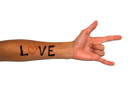 Love hand sign with  LOVE  written on the arm  Stock Photo - 13078449