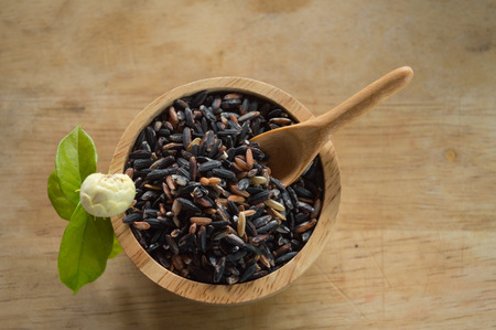 rice plate: rice in a cup on wood background