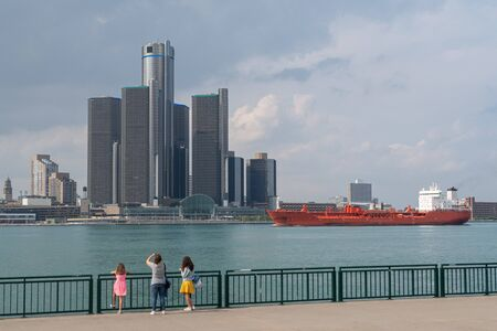 View of Detroit skyline with a ship from Windsor, Ontario