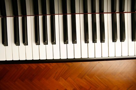 acoustically: detail of keys on a piano ready for concert