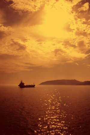 Shipping cargo oil and transport boat in sea with morning fog photo