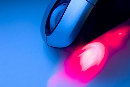 scrollwheel: Computer mouse with red laser in a tech background