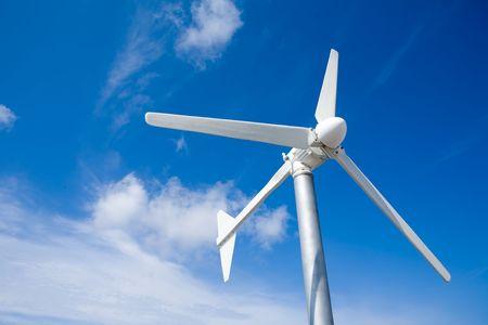 eolic wind turbine against a cloud blue sky