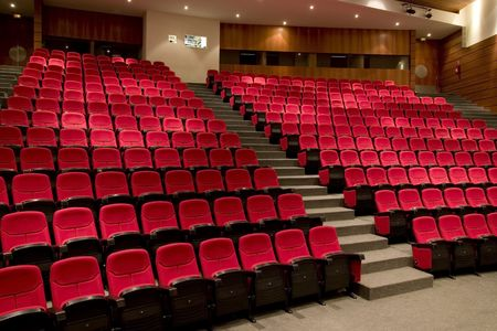 theater seat: empty theater auditorium cinema or conference hall.  Stock Photo