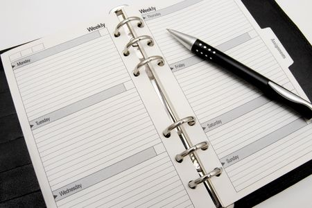 Blank business agenda  ready for writing photo