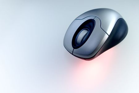 scrollwheel: Wireless mouse with red laser in a tech background
