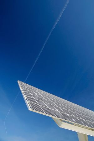Solar panel against blue sky. Good for issues such as renewable energies, air pollution, global warming. Stock Photo - 5234678