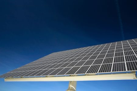 sustain: Solar panel against blue sky. Good for issues such as renewable energies, air pollution, global warming.