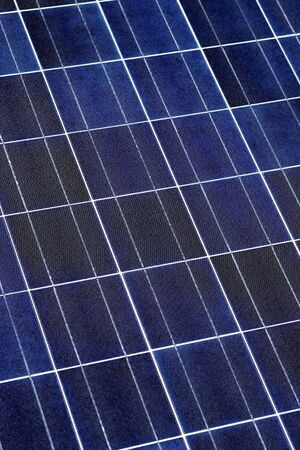 voltaic: Modern solar voltaic panel close up with great blue cells details in a perspective view. Great for energy and environment themes. Stock Photo