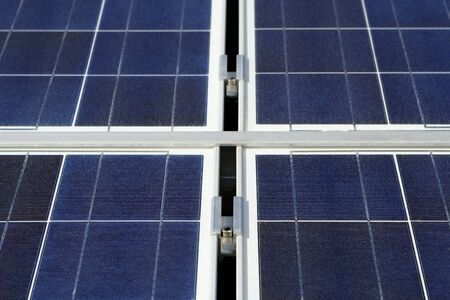 photoelectric: Modern solar voltaic panel close up with great blue cells details in a perspective view. Great for energy and environment themes. Stock Photo