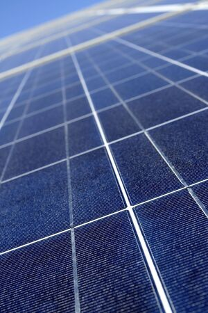Modern solar voltaic panel close up with great blue cells details in a perspective view. Great for energy and environment themes. Stock Photo