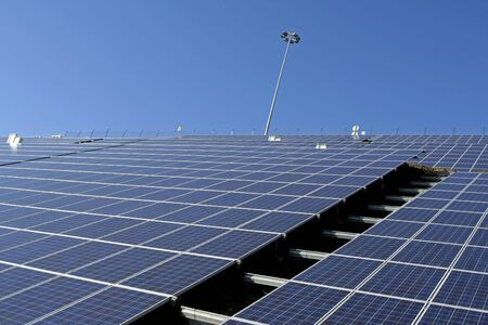 Modern solar voltaic panels with great blue cells with perspective view. Great for energy and environment themes.