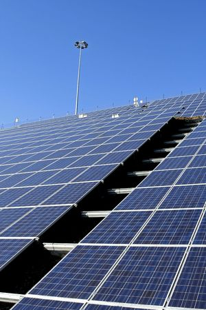 Modern solar voltaic panels with great blue cells with perspective view. Great for energy and environment themes. photo