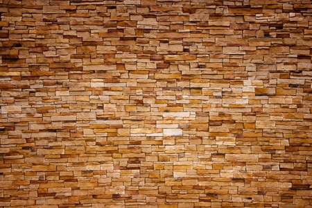 red brick repetition: Old handcraft wall background, great for wallpapers, architecture or construction themes
