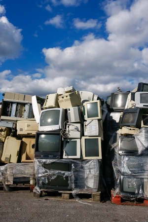 landfill: Modern electronic waste for recycling or safe disposal, any logos and brand names have been removed. Great for recycle and environmental themes.